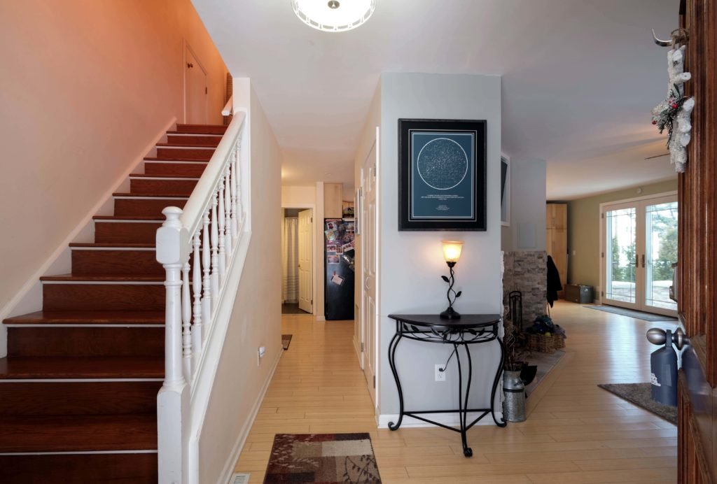 Entrance and stairwell up to three bedrooms.