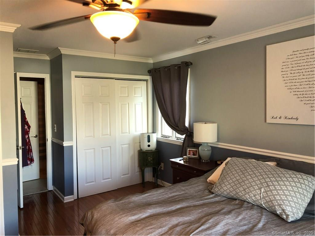 Master Bedroom, with hardwood floors and ceiling fan.