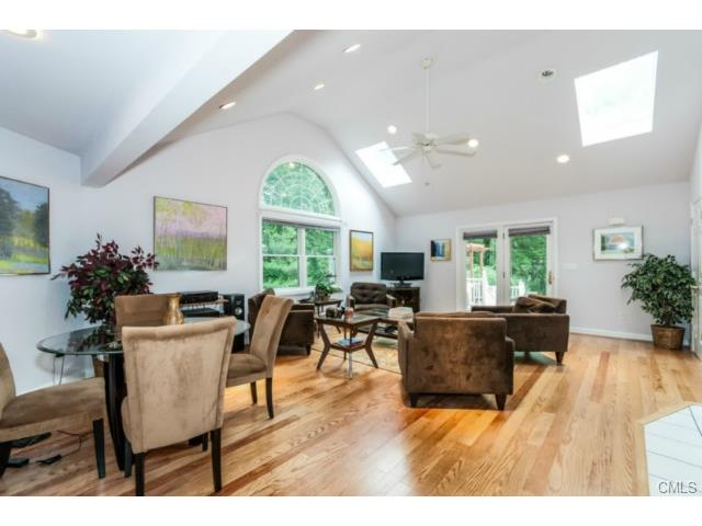 This Stone home is L-shaped offering a newly remodeled dynamic main level with fireplace, skylights, crown molding, recessed lightning, wet bar, including full bedroom and bath, perfect for in-law or Master bedroom suite. There is a sunny Artist studio with Fireplace enabling a creative ambience and includes separately attached bedroom with private entrance.