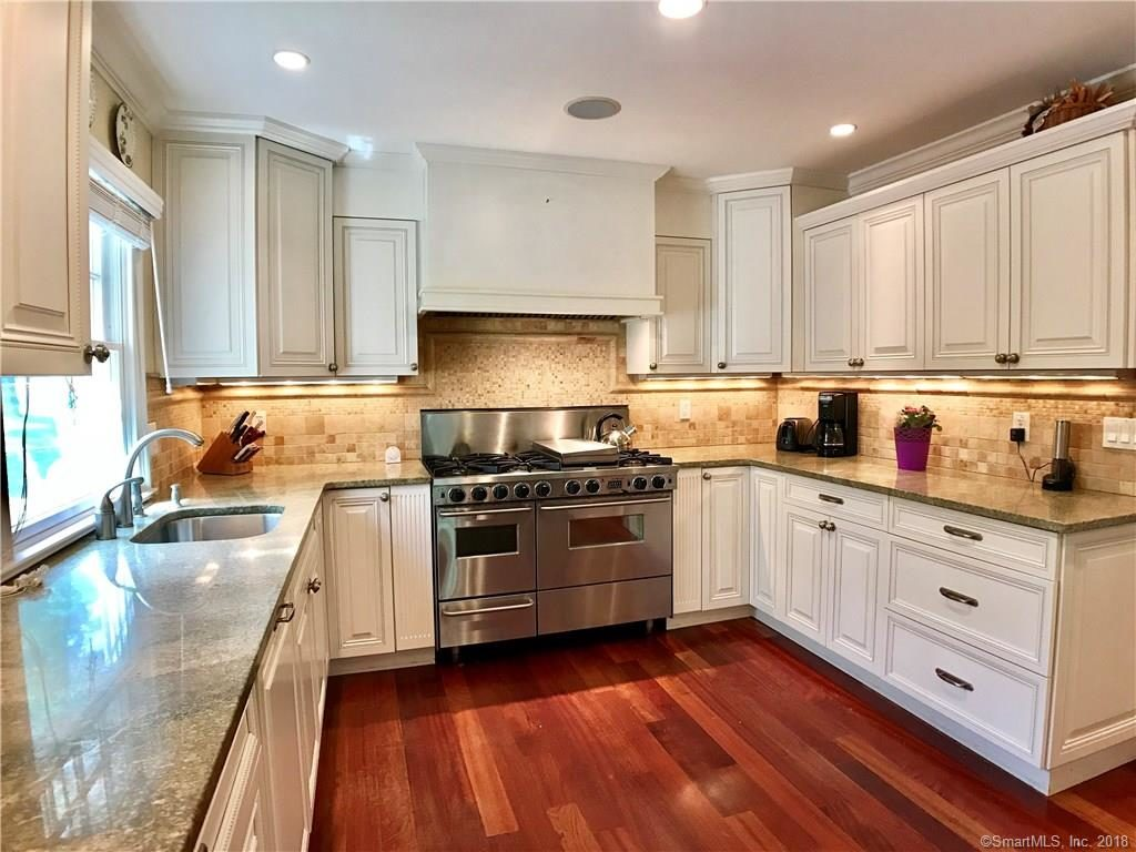 Totally modern kitchen with stainless steel appliances, granite, two dish washers, wine cooler, and six (6) burner stove. Brazilian cherry hardwood floors throughout