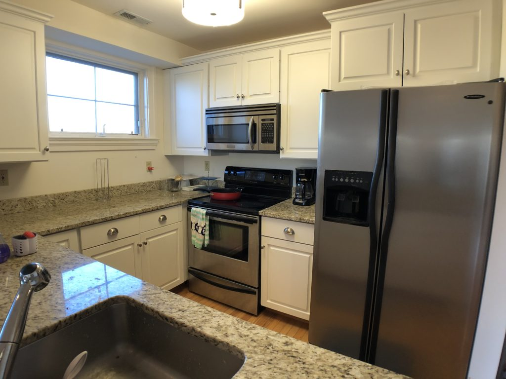 Kitchen with Stainless Steel Applicance Granite Counter Tops