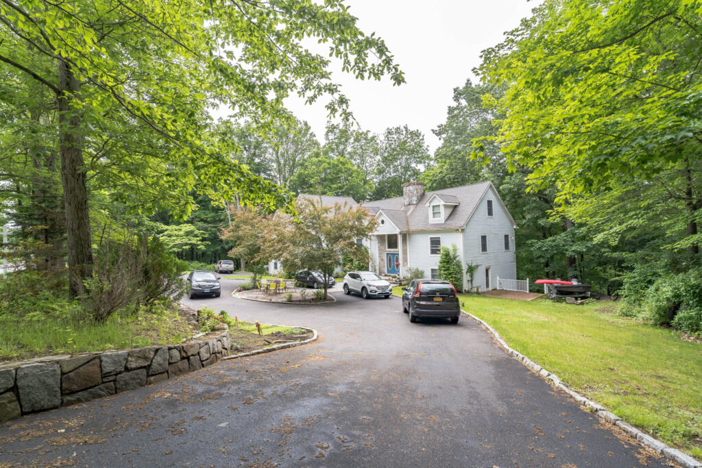 Exterior Front view with Circular Driveway 1078 Riverbank Road, Stamford, CT 06903